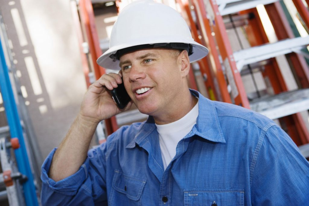 professional roofing contractor roofers talking on the phone