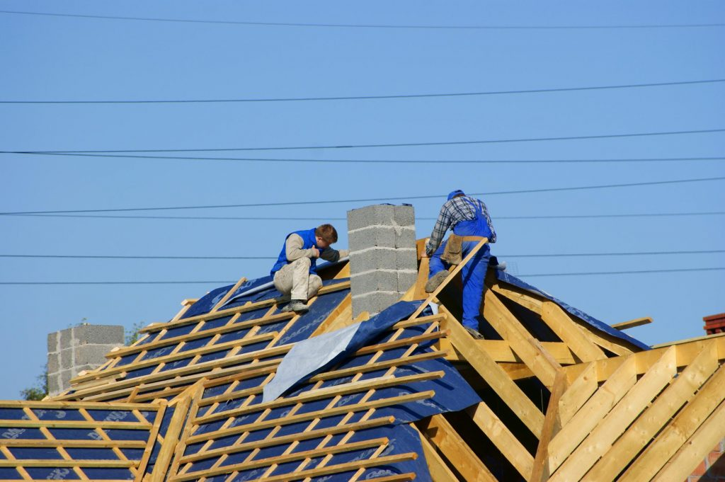 professional roofing contractor roofers doing roof installation