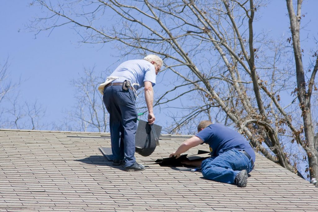 professional roofing contractor roofers doing roof repair